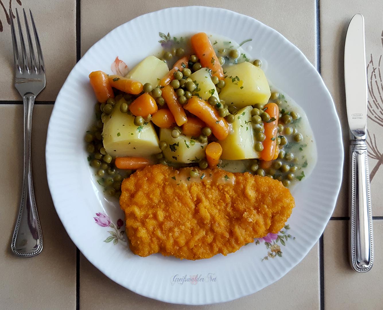 Schnitzel mit Frühkartoffeln und Mischgemüse